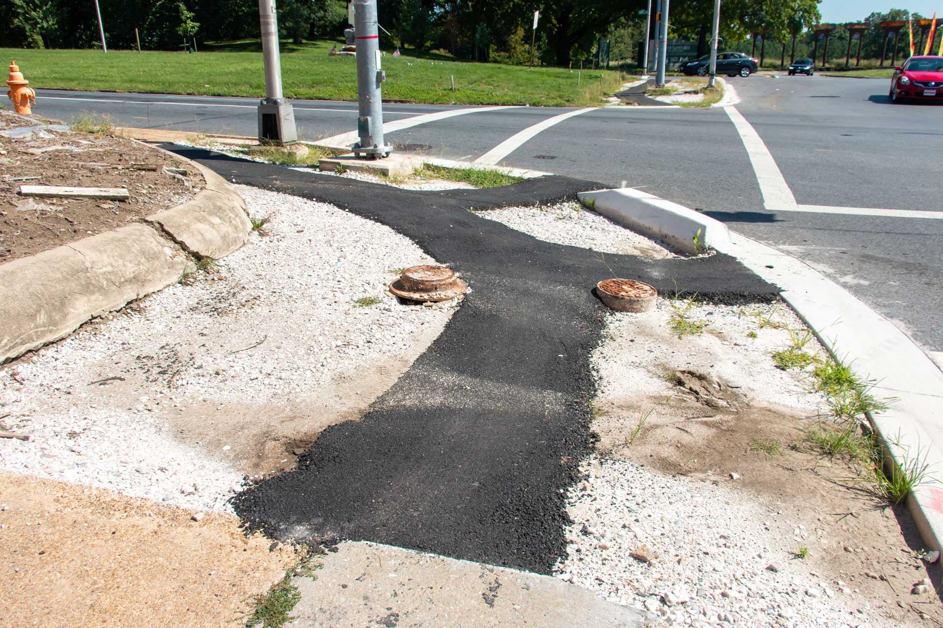 2016 removed sidewalks at Gwynns Falls Parkway and Auchentoroly Terrace